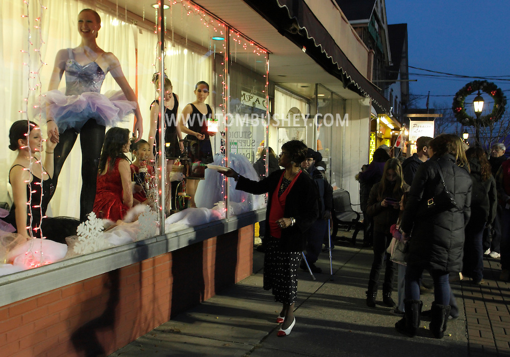 Pine Bush, New York - Dancers from the Mitchell Performing Arts Center pose in the center's window as people stand outside on the sidewalk during A Community Country Christmas 2011 on Dec. 3, 2011.