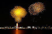 Fireworks display over a river at Kuwana City, Japan.