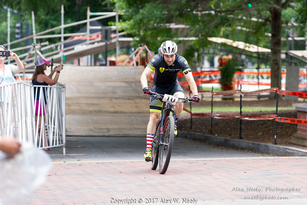 Besik Gavasheli (#10 GEO) heads down the straight toward the finish line during the 2nd heat of the quarter finals at the UCI Mountain Bike Eliminator World Cup in Columbus, GA (USA) on June 4, 2017.