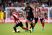 Joel Ward of Crystal Palace nut megs Phil Jagielka of Sheffield United during the Premier League match between Sheffield United and Crystal Palace at Bramall Lane, Sheffield, England on 18 August 2019.