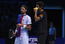 November 19, 2017 - London, England, United Kingdom - Marcelo Melo of Brazil and Lukasz Kubot of Poland in action against  Henri Kontinen of Finland and John Peers of Australia during day eight of the 2017 Nitto ATP World Tour Finals at O2 Arena on November 19, 2017 in London, England. (Credit Image: © Alberto Pezzali/NurPhoto via ZUMA Press)
