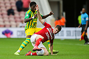 Middlesbrough midfielder Paddy McNair (17) under pressure from West Bromwich Albion defender Nathan Ferguson (36) during the EFL Sky Bet Championship match between Middlesbrough and West Bromwich Albion at the Riverside Stadium, Middlesbrough, England on 19 October 2019.