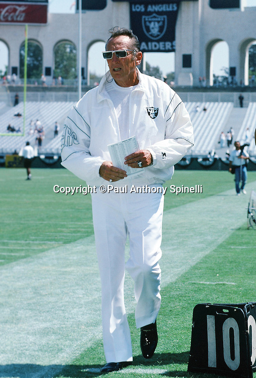 Los Angeles Raiders owner Al Davis paces the sideline during pregame warmups at the NFL football game against the Minnesota Vikings on Sept. 5, 1993 in Los Angeles. The Raiders won the game 24-7. (©Paul Anthony Spinelli)