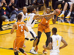 Jan 20, 2016; Morgantown, WV, USA; Texas Longhorns guard Tevin Mack (0) is guarded by West Virginia Mountaineers guard Daxter Miles Jr. (4) during the first half at the WVU Coliseum. Mandatory Credit: Ben Queen-USA TODAY Sports