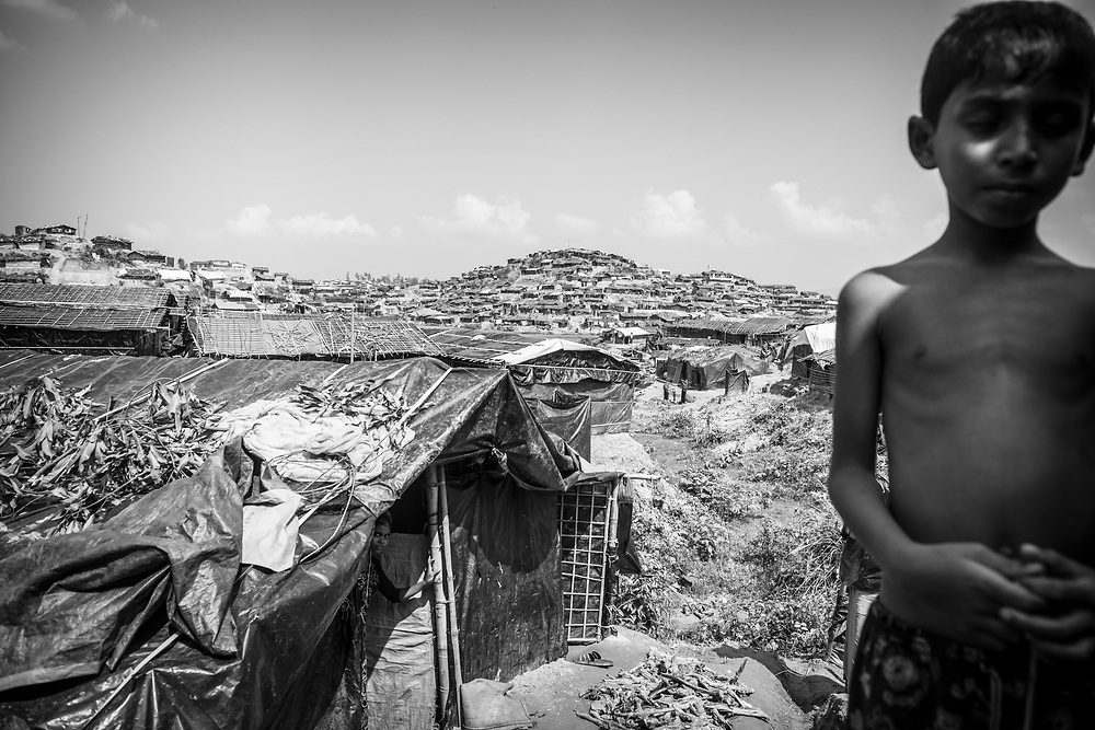 A Rohingya boy stands in Jamtoli refugee camp, Bangladesh (October 26, 2017)