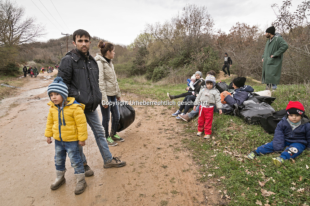 Greece, Idomeni, Refugees on their way to Europe,   March of Hope<br /> <br /> Refugees from Syria, Irak, Afghanistan and others from the near east are trying to reach the border between Greece and Macedonia (FYROM), they had to cross the small river Suva Reka, near the village Hamilo. <br /> Some refugees take a short brake on their walk to the border.<br /> <br /> Nadeloehr nach Nordeuropa Idomeni, der Grenzuebergang ist seit Tagen gesperrt,. <br /> Es ensteht im provisorischen Fluechtlingslager in Idomeni eine ngespannte Lage. <br /> Regen und Kaelte machen vor allem den Familien mit kleinen Kindern zu schaffen. <br /> <br /> Idomeni, is the eye of a needle for getting to nothern Europe. <br /> The FYRO macedonian authorities, closed the border from Greece completely. The situation close to the border gets more and more difficult. The People have to sleep outside or in small tents. <br /> Heavy rainfalls and cold nights are treating the refugees badly. Some already stayed up to ten nights at Idomeni. There is not enough food and supplies to help about 14.000 refugees<br /> <br /> <br /> keine Veroeffentlichung unter 50 Euro*** Bitte auf moegliche weitere Vermerke achten***Maximale Online-Nutzungsdauer: 12 Monate !! <br /> <br /> for international use:<br /> Murat Tueremis<br /> C O M M E R Z  B A N K   A G , C o l o g n e ,  G e r m a n y<br /> IBAN: DE 04 370 800 40 033 99 679 00<br /> SWIFT-BIC: COBADEFFXXX