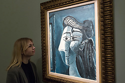 © Licensed to London News Pictures. 22/02/2018. LONDON, UK. A staff member views ''Tête De Femme'' by Pablo Picasso, (Est. £5,000,000 - 7,000,000) at the preview of Sotheby's upcoming Impressionist, Modern & Surrealist Art auctions taking place at Sotheby's, New Bond Street, on 28 February. Photo credit: Stephen Chung/LNP