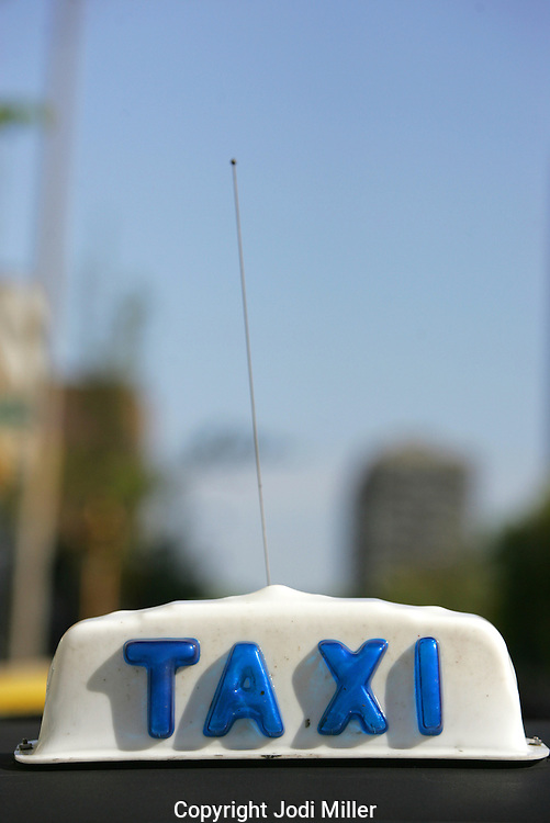 Taxicab sign on top of a cab in Milwaukee, Wisconsin.
