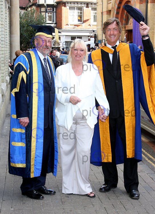 Richard Madeley receives Honorary Doctorate of Letters from Anglia Ruskin University at the Cambridge Corn Exchange, Cambridge. Accompanied by his family, wife Judy Finnigan and daughter Chloe, son Jack - October 12th 2011....Photo by Jill Mayhew