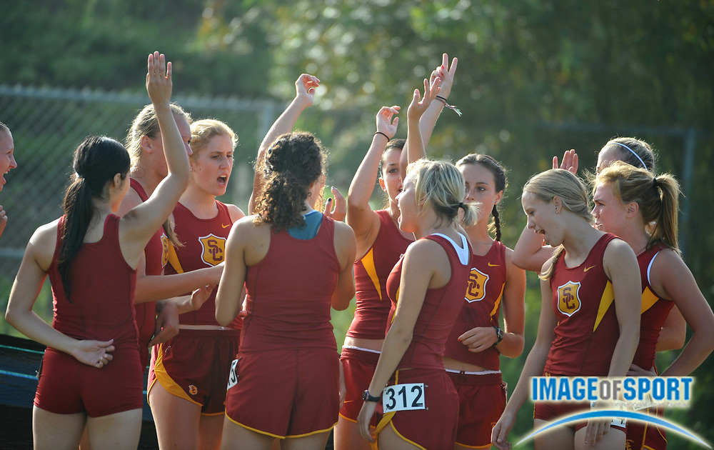 """Sep 6, 2008; Irvine, CA, USA; The Southern California women huddle before the start of the """"A"""" race in the UC Irvine Invitational at the Anteater Recreation Center Fields."""