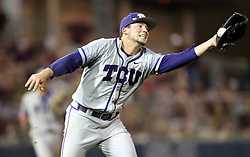 TCU's Jared Janczak (41) fields a hard hit line drive on the mound beore throwing to first base for an out against Texas A&M during the 8th inning of a NCAA college baseball super regional tournament game, Friday, June 10, 2016, in College Station, Texas. (AP Photo/Sam Craft)