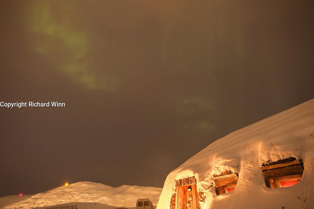 Aurora Borealis or Northern Lights over Mikkelgammen, just outside Hammerfest, Northern Norway.