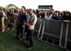 © licensed to London News Pictures. LONDON. UK.  02/07/11. Jamie Oliver watches The Charlatans headline day two  of The Big Feastival in Clapham Common. Jamie Oliver's The Big Feastival, is a three day event featuring food from some of the country's top chefs along with live music. The Big Feastival takes place on Clapham Common on the 1st, 2nd and 3rd July. All profits from the event will be shared between The Jamie Oliver Foundation and The Prince's Trust.  Mandatory Credit Stephen Simpson/LNP