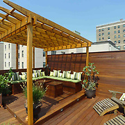 New York Rooftop terrace designed with two decks, pergola, cabana and custom furniture