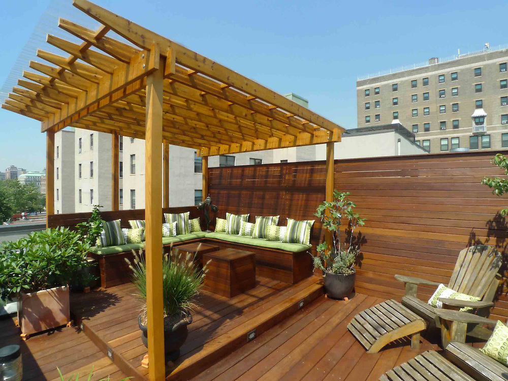 New york rooftop terrace with covered pergola featuring for Terrace roof design philippines
