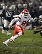 Kansas City Chiefs outside linebacker Tamba Hali (91) chases the action during the NFL week 12 regular season football game against the Oakland Raiders on Thursday, Nov. 20, 2014 in Oakland, Calif. The Raiders won their first game of the season 24-20. ©Paul Anthony Spinelli