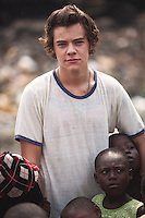 One Direction band member Harry Styles visits a rubbish tip in Agbogbloshie slum, Accra.
