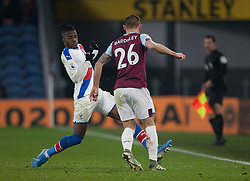 Wilfried Zaha of Crystal Palace (L) and Phillip Bardsley of Burnley in action - Mandatory by-line: Jack Phillips/JMP - 30/11/2019 - FOOTBALL - Turf Moor - Burnley, England - Burnley v Crystal Palace - English Premier League