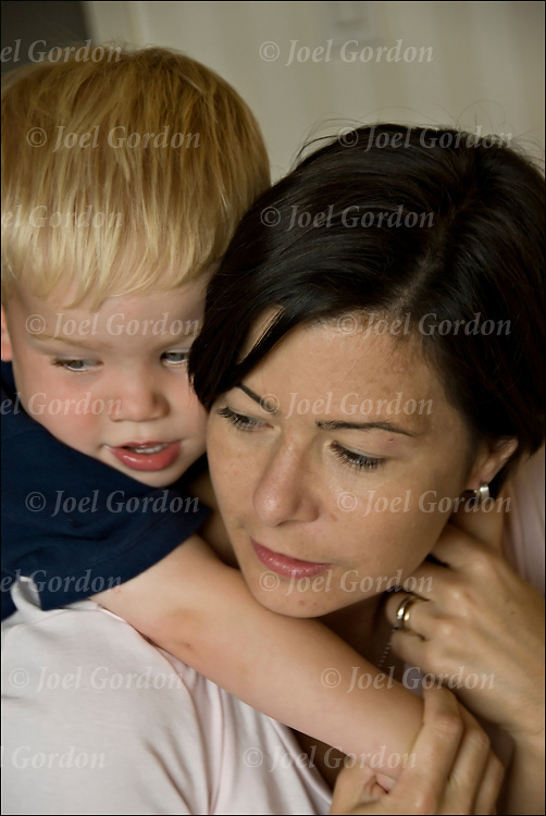 Mother with 3 year old son tender moment