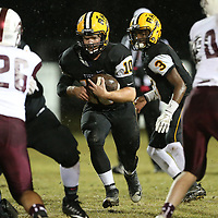 Ripley's Dylan Goolsby rushes through defenders during Friday night's game against New Albany.