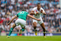 England Winger Anthony Watson is tackled by Ireland Fly-Half Johnny Sexton - Mandatory byline: Rogan Thomson/JMP - 07966 386802 - 05/09/2015 - RUGBY UNION - Twickenham Stadium - London, England - England v Ireland - QBE Internationals 2015.
