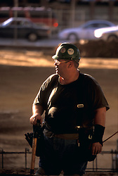 Stock photo of a workman with shovel during new construction at George R. Brown Convention Center in Houston, Texas