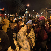 Protesters with the Black Lives Matter movement dance in the street as Nekima-Levy Pounds (pink hat), president of the Minneapolis NAACP, beat boxes during a night of community and protest outside the Minneapolis Police Department 4th precinct headquarters on Thursday, November 19, 2015 in Minneapolis, Minnesota. <br /> <br /> A more mellow and festive atmosphere, with a smaller police presence, prevailed after Wednesday evening's tear gas clashes between police and protesters. <br /> <br /> Protests and an encampment at the site have been ongoing since the police shooting of 24-year-old Jamar Clark by Minneapolis Police on Sunday, November 15. <br /> <br /> <br /> Photo by Angela Jimenez for Minnesota Public Radio www.angelajimenezphotography.com