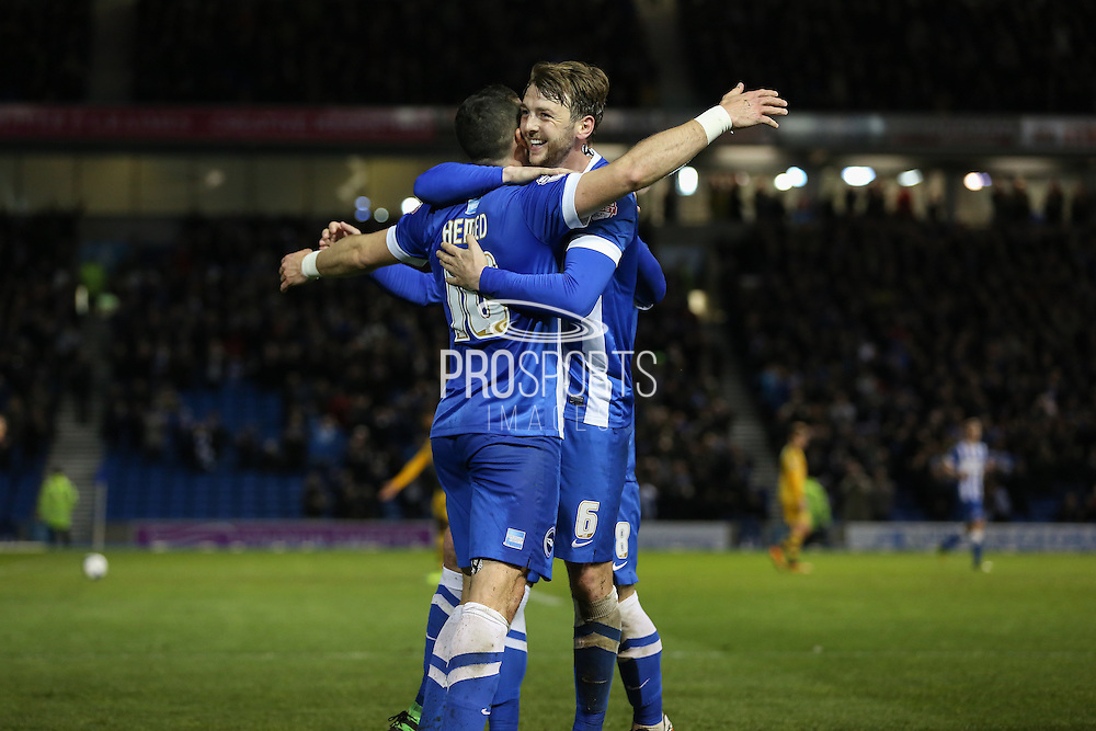 Brighton central midfielder, Dale Stephens (6) celebrates with Brighton striker, Tomer Hemed (10) after his goal during the Sky Bet Championship match between Brighton and Hove Albion and Fulham at the American Express Community Stadium, Brighton and Hove, England on 15 April 2016. Photo by Phil Duncan.