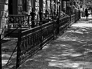 Iron fences along a street in Hoboken, NJ