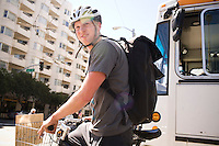 Brandon McGee rides on Fourth Street during a coffee delivery to SOMA (South of Market), in San Franicsco, Ca., on Monday, April 4, 2011. Bicycle Coffee Company is a San Francisco start-up taking green to a new level, by delivering hand-roasted coffee to over 100 local businesses, in addition to Whole Foods, by bicycle only. .Lianne Milton for The Wall Street Journal.Bay Area - Coffee Status