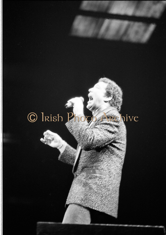 Tom Jones In Concert.    (T2)..1989..13.06.1989..06.13.1989..13th June 1989..As part of his Great Britain and Ireland tour, Tom Jones brought his show to the RDS tonight. Tom played to a packed house and thrilled the audience with all his classic hits and a few new songs also...The image shows Tom Jones giving his all with his performance, to his appreciative audience in the RDS,Dublin.
