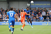 AFC Wimbledon defender Deji Oshilaja (4) battles for possession with Shrewsbury Town attacker Carlton Morris (9) during the EFL Sky Bet League 1 match between AFC Wimbledon and Shrewsbury Town at the Cherry Red Records Stadium, Kingston, England on 12 August 2017. Photo by Matthew Redman.