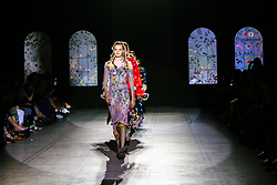 "© Licensed to London News Pictures. 21/06/2019. London, UK. Models present Preen by Thornton Bregazzi at the ""Fashion in Motion"" at V&A Museum, wearing colourful pieces from the designers' current collection and their archive themed around floral motifs and pagan references which coincides with the Summer Solstice and its celebration of light, nature and growth. Photo credit: Dinendra Haria/LNP"