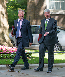 © Licensed to London News Pictures. 10/06/2014. Westminster, UK. (L-R) Owen Patterson, Conservative MP, Secretary  of  State  for  Energy  and  Climate Change  and <br /> Andrew Lansley CBE, Conservative MP,  arrive at Cabinet 10th June 2014. Photo credit : Stephen Simpson/LNP