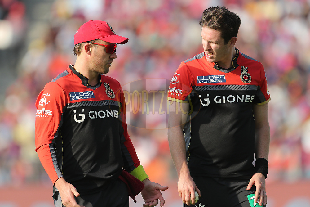 AB de Villiers of the Royal Challengers Bangalore and Adam Milne of the Royal Challengers Bangalore during match 34 of the Vivo 2017 Indian Premier League between the Rising Pune Supergiants and the Royal Challengers Bangalore   held at the MCA Pune International Cricket Stadium in Pune, India on the 29th April 2017<br /> <br /> Photo by Ron Gaunt - Sportzpics - IPL
