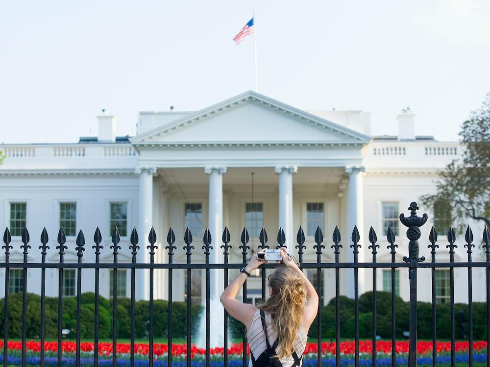 Woman taking pictures of the White House Washington DC USA&#xA;<br />