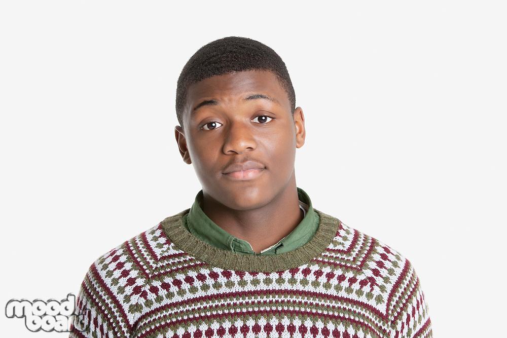 Portrait of an African American young man in sweater over gray background