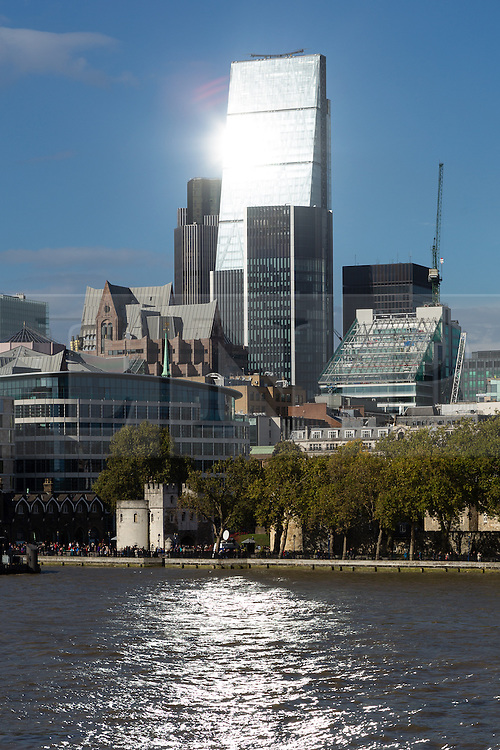© Licensed to London News Pictures. 09/10/2014. London, UK. Brilliant sunlight is reflected from the Leadenhall Building skyscraper, known as the Cheesegrater following a heavy rain shower this afternoon in London. Photo credit : Vickie Flores/LNP