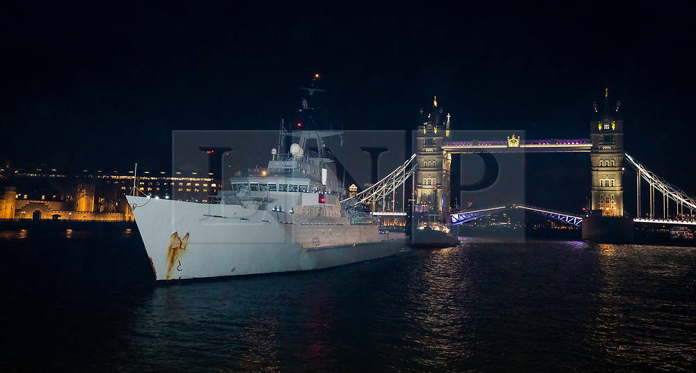 © Licensed to London News Pictures. 04/02/2020. London, UK. HMS Tyne arrives under Tower Bridge on the River Thames last night, 3rd February for a London visit. HMS Tyne is one of the three River-class patrol ships built to safeguard the fishing stocks and enforce national and EU fisheries legislation within British Fishery Limits, including protecting and patrolling in the Strait of Gibraltar. Along with HMS Severn and HMS Mersey, the fleet of three make up the Fishery Protection Squadron – the 'Cod Squad' – the oldest unit in the Royal Navy. Photo credit: Vickie Flores/LNP
