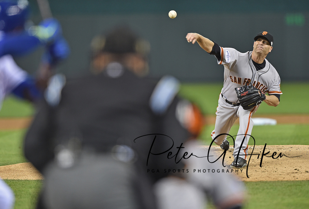 San Francisco Giants starting pitcher Tim Hudson throws a pitch against the Kansas City Royals in the first inning during game seven of the 2014 World Series at Kauffman Stadium.
