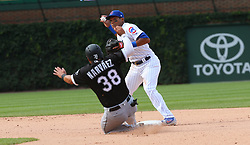 July 25, 2017 - Chicago, Illinois, US - Chicago Cubs shortstop Addison Russell turns a double play over the Chicago White Sox's Omar Narvaez (38) in the eighth inning at Wrigley Field in Chicago. The Cubs won, 7-2. (Credit Image: © Nancy Stone/TNS via ZUMA Wire)