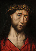 Christ Blessing, detail of Christ's face, weeping and bleeding from the Crown of Thorns, oil painting on wood, early 16th century Portuguese painting by an unknown artist, in the Musee des Beaux-Arts de Dijon, opened 1787 in the Palace of the Dukes of Burgundy in Dijon, Burgundy, France. Picture by Manuel Cohen
