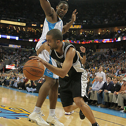 29 March 2009: San Antonio Spurs guard Tony Parker (9) drives past New Orleans Hornets center Hilton Armstrong (12) during a 90-86 victory by the New Orleans Hornets over Southwestern Division rivals the San Antonio Spurs at the New Orleans Arena in New Orleans, Louisiana.