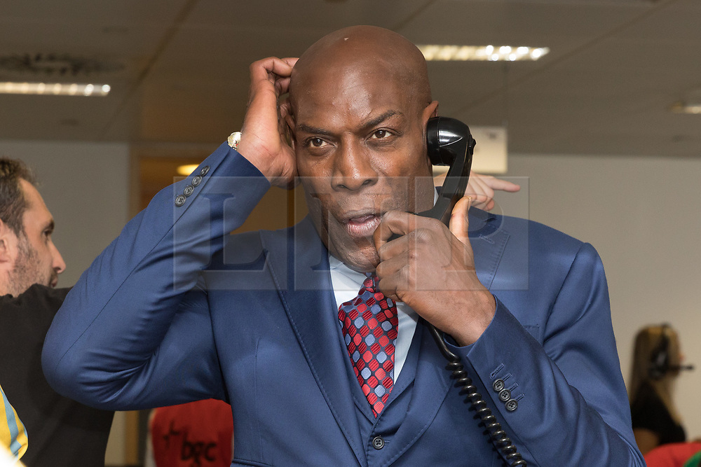 © Licensed to London News Pictures. 11/09/2018. London, UK.  Frank Bruno at the 14th Annual BGC Charity Day held on the trading floor of BGC Partners in Canary Wharf, to raise money for charitable causes in commemoration of BGC's 658 colleagues and the 61 Eurobrokers employees lost on 9/11.  Photo credit: Vickie Flores/LNP