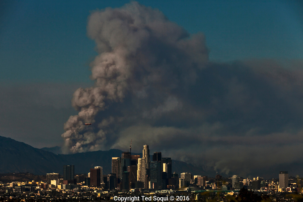 Fires in mountains above Duarte. <br /> Two fires converge, the Fish and the Reservoir Fires, sending heavy smoke plumes in to the Los Angeles basin.