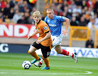 Molineux Grounds Wolverhampton Wanderers v Portsmouth (0-1) Premier League 03/10/2009<br /> Andy  Keogh (Wolves) Jamie O'Hara (Portsmouth)<br /> Roger Parker Fotosports International