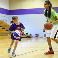070314       Cayla Nimmo<br /> <br /> Adyson Sploar learns how to dribble a ball during basketball camp at Miyamura High School in Gallup Thursday morning.