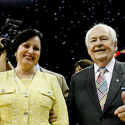 April 19, 2012; New Orleans, LA, USA; New Orleans Hornets and Saints owner Tom Benson and his wife Gayle Benson walk off the court a confetti falls behind them following a win over the Houston Rockets at the New Orleans Arena. The Hornets defeated the Rockets 105-99.   Mandatory Credit: Derick E. Hingle-US PRESSWIRE