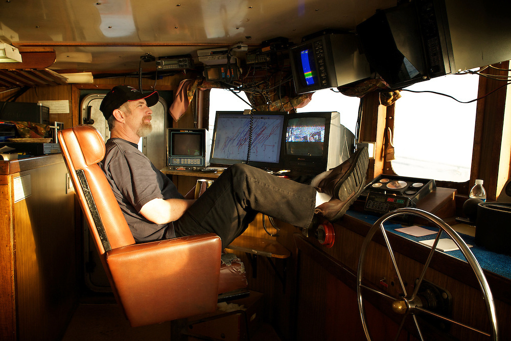 Captain Ted Gibson keeps an eye on the direction of the morning trawl