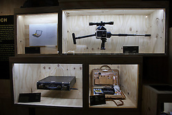 © licensed to London News Pictures. London, UK 05/07/2012. Hasselblad Gun (top right) and suitcases with many gadgets  being shown with many Bond items which have been used in the movies in the last 50 years at Designing 007 exhibition at Barbican Centre. Photo credit: Tolga Akmen/LNP